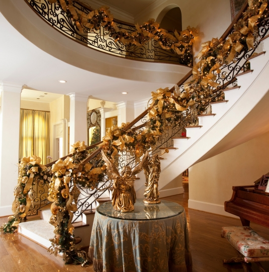 suzy-q-better-decorating-bible-blog-ideas-christmas-holiday-theme-gold-shimmering-glittery-ornaments-garland-staircase-tree-elegant-traditional-ribbon-bows-green-pale-yellow.jpg