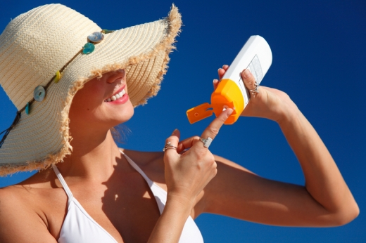 woman-with-hat-applying-sunscreen.jpg